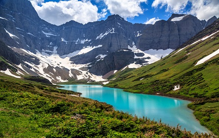 The turquoise colored Cracker Lake, with Siyeh Glacier in the background, located in Many Glacier region, Glacier National Park, Montana, USA.