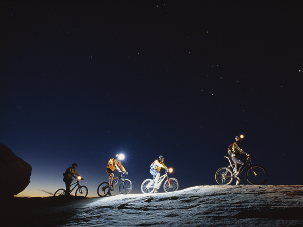Mountain bikers finish up the 'slickrock trail' at dusk.